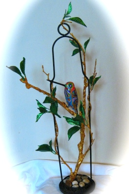 papie-mache bird in tree banches made for sister by pamela spiro wagner,