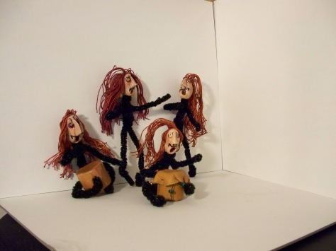 Beatnik Band of polymer clay heads on Pipecleaners -- leather drums made of old purses