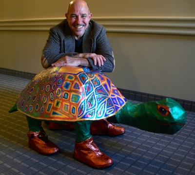 Tim with Papier Mache Turtle I made for him