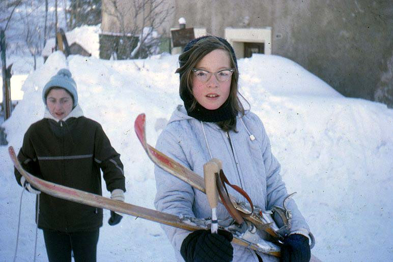 Carolyn Spiro with skis, probably early to mid 60s (not shoveling snow!)